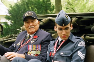 Dutch liberation vet Ron Charland (left) is joined by air cadet Bo Gibbons during VE Day parade in Apeldoorn, May 9, 2010.