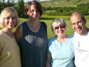 At Sage Hill Writing Experience, writers (l-r) Shar Mitchell, Gayle Sacuta and Linda Killick, pose with Ted Barris in the Saskatchewan sunshine.