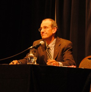 Moderating one of several candidates' debates (photo by Vanessa Brown).