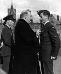 Prime Minister William Lyon Mackenzie King pins wings on the uniform of an early graduate of the British Commonwealth Air Training Plan during a symbolic ceremony on Parliament Hill. King made sure the plan became an entirely made-in-Canada phenomenon.