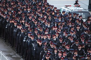 Police officers file toward the Toronto Convention Centre on Jan. 19 to attend the funeral of Sgt. Ryan Russell. As many as 12,000 law enforcement and emergency response officials from across the continent attended the event. Photo courtesy Octavian Lacatusu.
