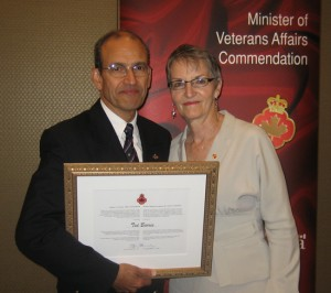 Ted Barris and Jayne MacAulay, his wife, and his commendation certificate. Photo courtesy Kate Barris.