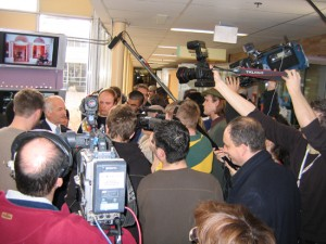 Jack Layton (left) in a media scrum during the 2006 federal election.