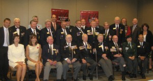 Nineteen recipients of a Commendation from Minister of Veterans Affairs, MP Steven Blaney (second from left back row).