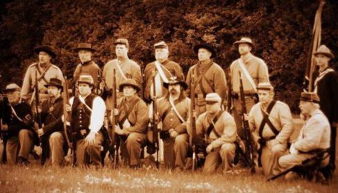 fourth from left) in authentic Civil War attire and equipment