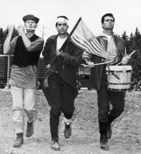 "Steve McQueen, Jud Taylor and James Garner - as POWs in Stalag Luft III - celebrate the 4th of July in the movie ""The Great Escape."""