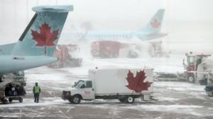 The Pearson tarmac showed the ill effects of an ice storm on airline traffic.