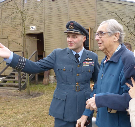 Museum director in RAF uniform escorts real kriegie Andy Wiseman to mock inspection at the camp.