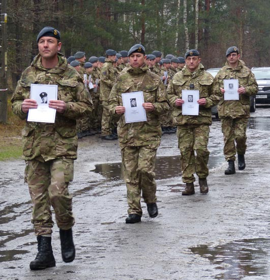 50 young RAF officers marched with pictures of the 50 murdered officers.