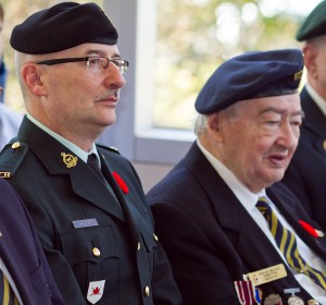 Bill Walker beside his father Howard during Centennial College's Remembrance Day observance.