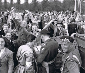 Citizens of Utrecht celebrate newfound freedom on May 5, 1944, with their British and Canadian liberators.