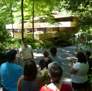 Guide Nathan Schultz (with walking stick) about to lead tour into Fallingwater.