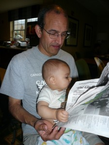 Reading the Cosmos community newspaper with my grandson - initiating his contact with hard copy early.