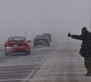 Local Input~ Environment Canada reported widespread near-zero visiblity conditions in Regina and area on Sunday, prompting a blizzard warning.  Lukkas Sinclair from Juneau, Alaska, braving the howling wind, was still determined to catch a ride after an hour on the Trans-Canada Highway east of Prince of Wales Drive.  The blustery conditions spread southward to the U.S. border and north to the Yellowhead Highway.  In the city, temperatures hovered around -20 C.  With the wind chill, it felt at times as if it was about -35 C.