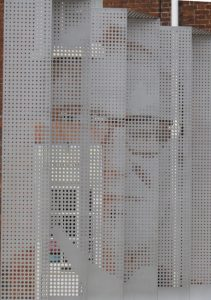 The Bill Tutte Memorial includes this large steel sculpture with teletype dots outlining the face of the man who broke Lorenz.
